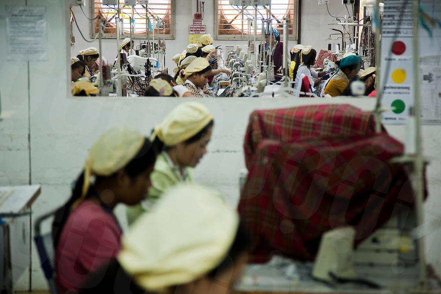 July 06, 2009 - Phnom Penh, Cambodia. Garment factory workers. © Nicolas Axelrod / Ruom