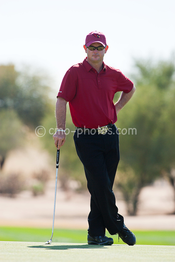 Feb 1, 2009; Scottsdale, AZ, USA; Rory Sabbatini (RSA) stands on the 7th green during the final round of the FBR Open at the TPC Scottsdale.  The former Arizona Wildcats golfer wore an Arizona Cardinals hat as the Cardinals would play in Super Bowl XLIII later that day.  Mandatory Credit: Chris Morrison-US PRESSWIRE