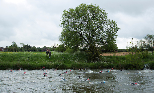25 MAY 2014 - BRIGG, GBR - Competitors swim along the River Ancholme during the World Quadrathlon Federation 2014 Middle Distance World Championships at the Brigg Bomber in Brigg in Lincolnshire, Great Britain (PHOTO COPYRIGHT © 2014 NIGEL FARROW, ALL RIGHTS RESERVED)