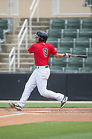 Christian Stringer (8) of the Kannapolis Intimidators follows through on his swing against the Lakewood BlueClaws at CMC-Northeast Stadium on May 17, 2015 in Kannapolis, North Carolina.  The Intimidators defeated the BlueClaws 4-1.  (Brian Westerholt/Four Seam Images)