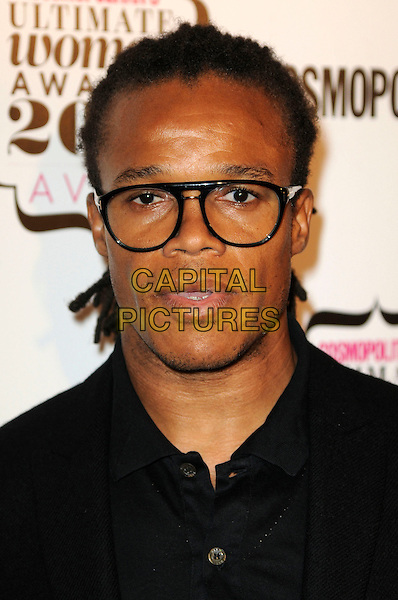 EDGAR DAVIDS  .Cosmopolitan Ultimate Women Of The Year Awards, Banqueting House, Whitehall Place, London, England..November 2nd, 2010.headshot portrait black glasses .CAP/CAS.©Bob Cass/Capital Pictures.