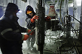 Workers prepare to drill into the permafrost at a well in Yamal, Russia. The drill bit, embedded with diamond discs along the cutter, costs around 50,000 euros each. It is pushed down by a 10-ton load and turns at up to 200 revs per minute. <br /> <br /> Russia has some of the world's largest natural gas deposits.