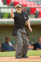 Home plate umpire Brad Myers makes a strike call during the International League game between the Toledo Mud Hens and the Charlotte Knights at Knights Stadium on May 7, 2012 in Fort Mill, South Carolina.  (Brian Westerholt/Four Seam Images)