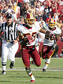 Washington Redskins wide receiver Santana Moss (89) carries the ball after making a catch during the game against the Seattle Seahawks at FedEx Field in Landover, Maryland on October 2, 2005.  The Redskins won the game in overtime 20 - 17.<br />