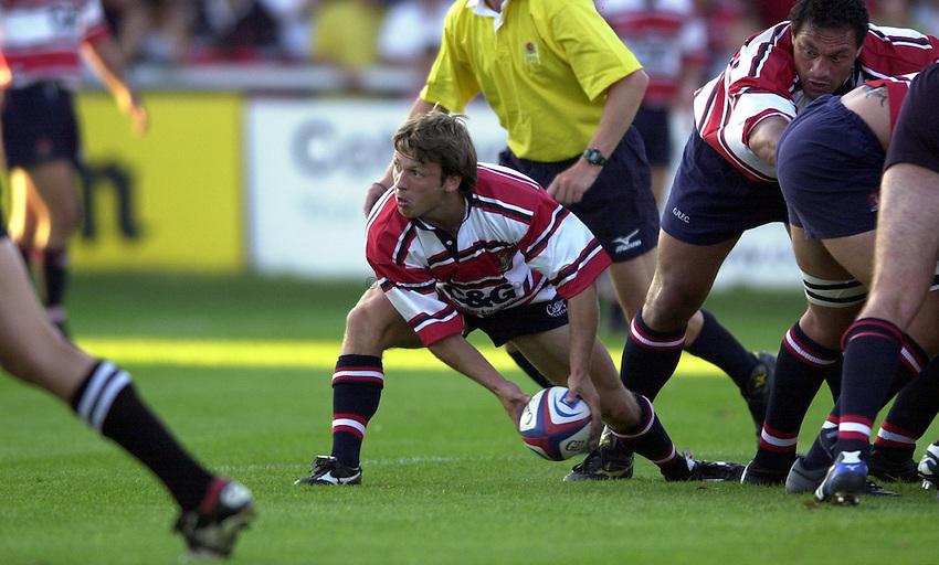 Photo: Richard Lane..Gloucester v Glasgow Rugby Pre seaon friendly. 14/08/2003..Simon Amor gets the ball away.