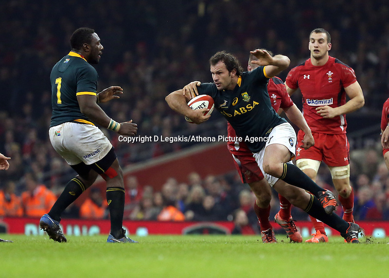Pictured: Bismarck du Plessis of South Africa (with ball) Saturday 29 November 2014<br /> Re: Dove Men Series 2014 rugby, Wales v South Africa at the Millennium Stadium, Cardiff, south Wales, UK.