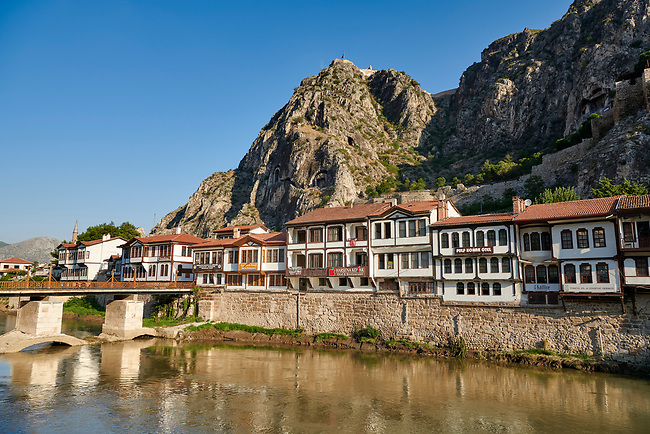 Ottoman villas of Amasya along the banks of the river Yesilırmak k, below the Pontic Royal rock tombs and mountain top ancient citadel, Turkey
