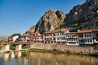 Ottoman villas of Amasya along the banks of the river Yesilırmak k, below the Pontic Royal rock tombs and mountain top ancient citadel, Turkey
