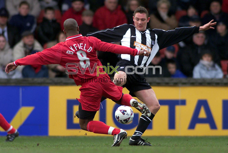 Pix, Shaun Flannery/SWpix. Nationwide League Division One..Grimsby Town v Walsall, 9/3/2002..COPYRIGHT PICTURE>>SIMON WILKINSON>>01943 - 436649>>..Grimsby's Tony Gallimore challenges Walsall's Darren Byfield.