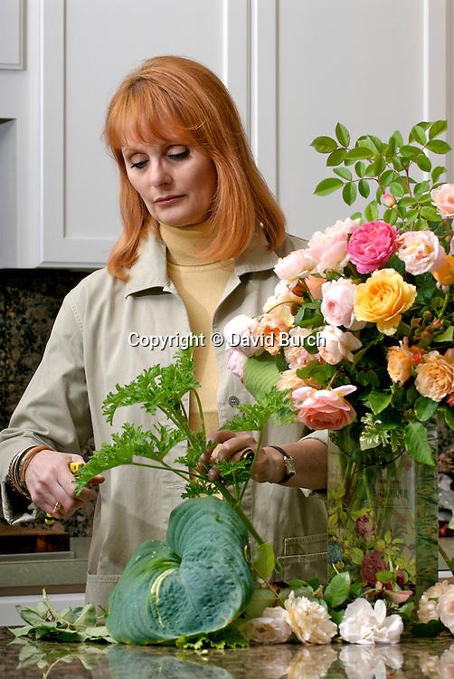 Mature woman arranging flower bouquet
