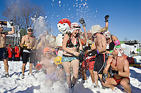 Quebec City - February 16, 2008. Carnival-goers have fun with Bohomme Carnaval during the annual Snow Bath, an highlight of the Quebec Winter Carnival. The temperature was -15 during the event.