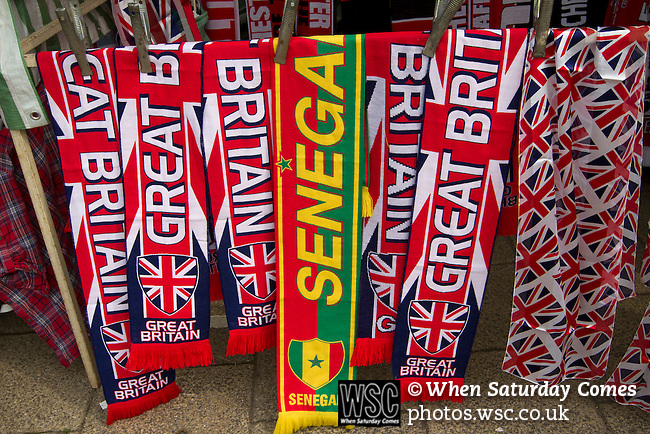 Uruguay 2 United Arab Emirates 1, Great Britain 1 Senegal 1, 26/07/2012. Old Trafford, Olympic Games. Souvenir scarves on sale close to Manchester United's Old Trafford stadium prior to the Men's Olympic Football tournament matches at the venue. The double header of matches resulted in Uruguay defeating the United Arab Emirates by 2-1 while Great Britain and Senegal drew 1-1. Over 72,000 spectators attended the two Group A matches. Photo by Colin McPherson.