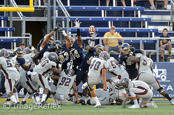 19 September 2015:  FIU's special teams unit (pictured, defensive tackle Imarjaye Albury (93), defensive tackle Darrian Dyson (44), defensive end Michael Wakefield (55)) attempt to block an extra point in the first half as the FIU Golden Panthers defeated the North Carolina Central University Eagles, 39-14, at FIU Stadium in Miami, Florida.