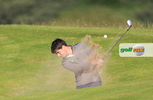 Dermot McElroy (Ballymena) plays out of a bunker on the 4th fairway during Round 3 of Matchplay in the North of Ireland Amateur Open Championship at Portrush Golf Club, Portrush on Thursday 14th July 2016.<br /> Picture:  Thos Caffrey / www.golffile.ie