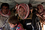 11/12/2014. Fishkhabour, Iraq. An elderly Yazidi refugee holds a young relative as he waits for his chance to leave an Iraqi Air Force Mi-171E Hip helicopter and be processed by members of the UNHCR after being evacuated from Mount Sinjar.<br /> <br /> Although a well publicised exodus of Yazidi refugees took place from Mount Sinjar in August 2014 many still remain on top of the 75 km long ridge-line, with estimates varying from 2000-8000 people, after a corridor kept open by Syrian-Kurdish YPG fighters collapsed during an Islamic State offensive. The mountain is now surrounded on all sides with winter closing in, the only chance of escape or supply being by Iraqi Air Force helicopters.