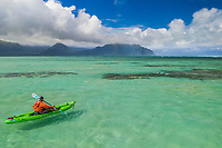 A kayaker navigates the waters at Kaneohe Sandbar (or Ahu o Laka), Windward O'ahu.