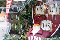 Wigglesworth Hall (left), one of Harvard's freshman dorms, is seen reflected in the window of the J. August Shirt Shop in Harvard Square near Harvard University in Cambridge, Massachusetts, USA, on Mon., Oct 15, 2018.