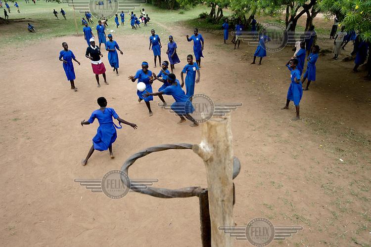 Girls playing netball at Aputiri Primary School.
