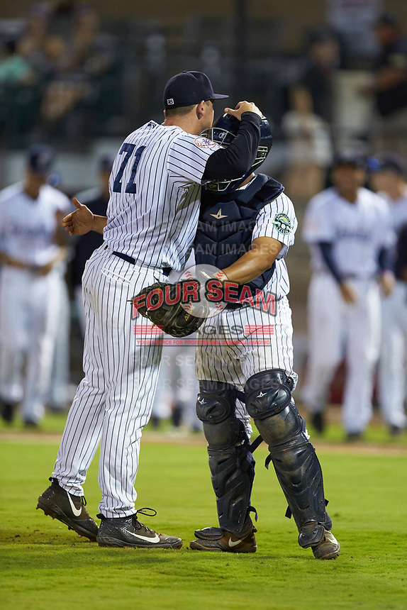 Pulaski Yankees relief pitcher Hayden Wesneski (71) hugs catcher Gustavo Campero (24) after getting the final out in the game against the Burlington Royals at Calfee Park on August 31, 2019 in Pulaski, Virginia. The Yankees defeated the Royals 6-0. (Brian Westerholt/Four Seam Images)