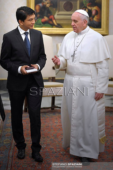 Pope Francis receives Madagascar's transitional leader Andry Rajoelina at the end of a private audience in his private library at the Vatican on  April 26, 2103...