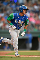 Third baseman Carlos Diaz (14) of the Lexington Legends runs out a batted ball during a game against the Greenville Drive on Saturday, September 1, 2018, at Fluor Field at the West End in Greenville, South Carolina. Greenville won, 9-6. (Tom Priddy/Four Seam Images)