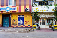 Indonesia, Riau, Batam. Two of the many pubs in Nagoya, Ice Pub and Sugar Pub.