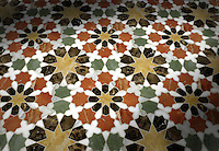 Granada, a stone waterjet mosaic in Emperador Dark, Verde Luna, Rojo Alicante, Calacatta Tia and Giallo Reale polished. Paul Schatz for New Ravenna Mosaics.