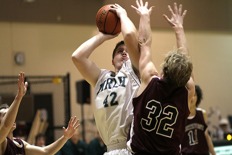 Photograph from the 2009-10 Mt. Rainier Lutheran High School boy's basketball season.