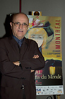 Montreal World Film Festival's President &amp; founder ; <br /> Serge Losique,pose for photographers beside a poster of this year Festival , August 6th, 2001 in Montreal, CANADA.<br /> <br /> This year mark the 25th anniversary of the Montreal World Film Festival<br /> <br /> <br />  File Photo Agence Quebec Presse - Pierre Roussel