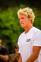 "HONOLULU, Oahu, Waimea Bay - Thursday, November 28, 2012 John John Florence (HAW). -- The 28th annual Quiksilver In Memory of Eddie Aikau official opening ceremony and blessing today at Waimea Bay on the North Shore of Oahu. The ceremony  featured this year's 28 Invitees, including newly elected riders John John Florence (Hawaii), Ian Walsh (Maui), and Alex Gray (California), as well as former ""Eddie"" champions Kelly Slater (Florida), Greg Long (California), and Ross Clarke-Jones (Australia). The surfers will be joined by members of the Aikau family, including Eddie's younger brother and Invitee Clyde Aikau...When the Invitees and Alternates paddled out and grouped in the traditional surfer's circle it's about camaraderie and making a connection to the others who will ultimately share in your experience and watch out for your safety..The holding period for the Quiksilver In Memory of Eddie Aikau will commence on Saturday, December 1, and runs through  to February 28, 2013. The event requires one day of quality waves in the giant range of 20 feet or more. Waves of this size are only generated occasionally by hurricane force winds from intense storms in the Pacific NW. The elements of wind, swell height and arrival time to the island's shore must be in perfect alignment to allow a full eight hours of daytime competition..Waimea Bay was Eddie Aikau's home away from home. It was here that he saved countless lives as the Bay's first official lifeguard, and successfully rode the largest waves of his day. An early pioneer of big wave riding in Hawaii, Eddie has inspired generations of ""storm surfers"" who today roam the globe year-round in search of giant waves..The Quiksilver In Memory of Eddie Aikau has only been held a total of eight (8) times, most recently on December 8, 2009. California's Greg Long (California) took the honor that year. .Photo: joliphotos.com"