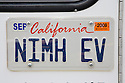 A close up of an 'NIMH EV' (Nickel-Metal Hybride Electric Car) license plate of Electric Ford Ranger truck at an Electric Vehicle Rally in Palo Alto. Hosted by the Silicon Valley Chapter of the Electric Auto Association. Palo Alto, California, USA