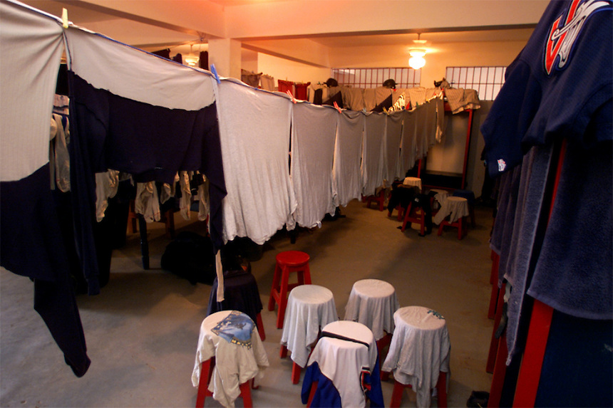 024222.SP.0114.angels15.kc--San Pedro de Macoris, Dominican Republic--In the Angels' facility locker room players uniforms hang to dry after their game against the Boston Red Sox Academy team. Baseball academies are ran by several MLB teams giving young Dominican boys a chance at the big leagues. They are housed fed and paid to play baseball.