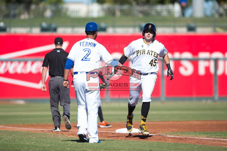 Surprise Saguaros first baseman Will Craig (45), of the Pittsburgh Pirates organization, is congratulated by third base coach Andy Fermin (2) after hitting a home run during an Arizona Fall League game against the Glendale Desert Dogs at Surprise Stadium on November 13, 2018 in Surprise, Arizona. Surprise defeated Glendale 9-2. (Zachary Lucy/Four Seam Images)