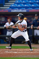 Canisius College Golden Griffins center fielder John Conti (23) squares to bunt during the first game of a doubleheader against the Michigan Wolverines on February 20, 2016 at Tradition Field in St. Lucie, Florida.  Michigan defeated Canisius 6-2.  (Mike Janes/Four Seam Images)