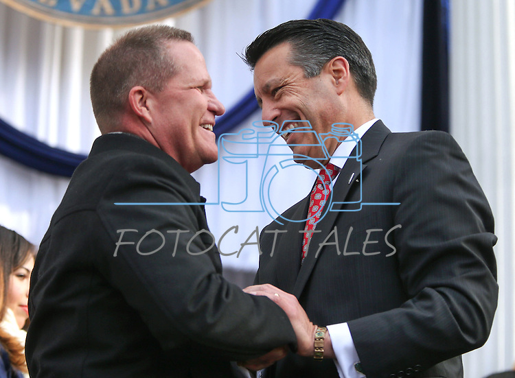 Lt. Gov. Mark Hutchison, left, and Gov. Brian Sandoval congratulate each other following the inauguration at the Capitol, in Carson City, Nev., on Monday, Jan. 5, 2015. (Las Vegas Review-Journal/Cathleen Allison)