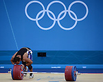 LONDON, ENGLAND - AUGUST 3:  Tarek Abdelazim of Egypt kisses the weights  after a unsuccessful lift during the Men's 85Kg Weightlifting Final Day 7 of the London 2012 Olympic Games on August 3, 2012 at the Excell Center in London, England. (Photo by Donald Miralle)