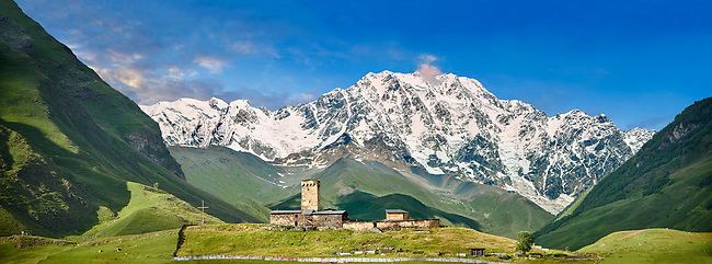 """The medieval Georgian Orthodox St George Church """"JGRag"""" with mount Shkhara (5193m) behind, Ushguli, Upper Svaneti, Samegrelo-Zemo Svaneti, Mestia, Georgia. At 2,200 m (7217 ft) above sea level in the Caucasus mountains St George Church is one of  the highest in Europe. Mount Shkhara is the highest mountain in the Caucasus range."""