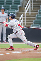 Andrew Knapp (16) of the Lakewood BlueClaws follows through on his swing against the Kannapolis Intimidators at CMC-NorthEast Stadium on July 19, 2014 in Kannapolis, North Carolina.  The Intimidators defeated the BlueClaws 8-4. (Brian Westerholt/Four Seam Images)