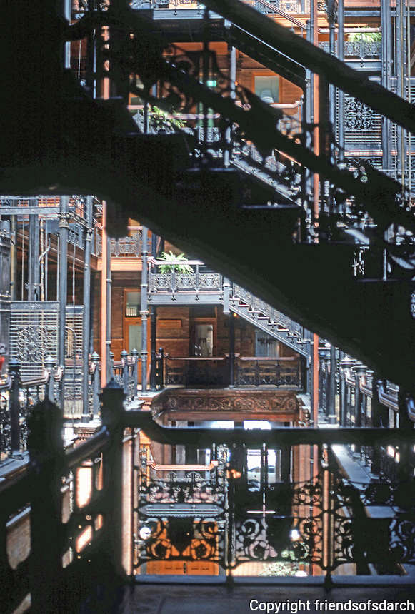 Los Angeles: Bradbury Building.  Natural light flows through wrought-iron stairs. Photo '78.