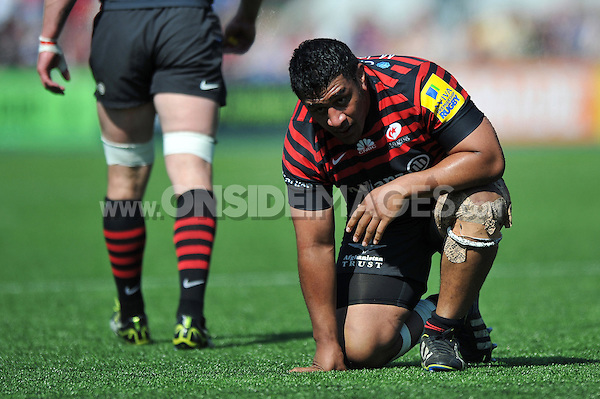 Mako Vunipola takes a breather during a break in play. Aviva Premiership match, between Saracens and Northampton Saints on April 13, 2014 at Allianz Park in London, England. Photo by: Patrick Khachfe / JMP
