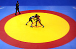 GUADALAJARA, MEXICO - OCTOBER 21:  Diego Romanelli of Brazil grapples with Hansen Lenier Meoque of Cuba in the Men's Greco-Roman Wrestling 60kg Quarterfinal Bout during Day Six of the XVI Pan American Games at the Code II Sports Complex on October 21, 2011 in Guadalajara, Mexico.  (Photo by Donald Miralle for Mexsport) *** Local Caption ***