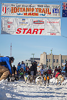 Matt Failor and team leave the ceremonial start line at 4th Avenue and D street in downtown Anchorage during the 2014 Iditarod race.<br /> Photo by Jim R. Kohl/IditarodPhotos.com