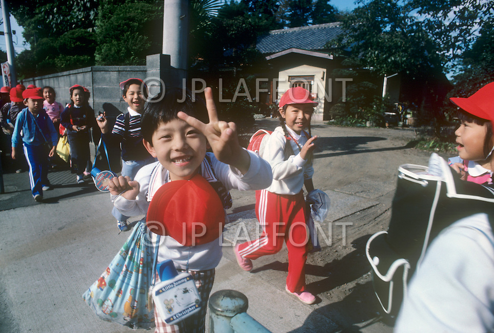 October, 1980. Tokyo, Japan. Japanese children on their way to school in the morning.