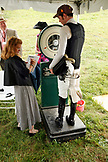 USA, Tennessee, Nashville, Iroquois Steeplechase, a jockey weighs-in before the first race