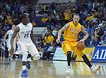 February 7, 2015 - Colorado Springs, Colorado, U.S. -  Wyoming guard, Josh Adams #14, works the top of the key during an NCAA basketball game between the University of Wyoming Cowboys and the Air Force Academy Falcons at Clune Arena, U.S. Air Force Academy, Colorado Springs, Colorado.  Air Force soars to a 73-50 win over Wyoming.