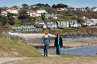 Pictured: Two women walk on the coastal path by Langland Bay near Swansea, Wales, UK. Sunday 22 March 2020<br /> Re: Covid-19 Coronavirus pandemic, UK.