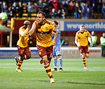 Peter Hartley heads in the second goal for Motherwell and laughs at the Aberdeen fans as he celebrates