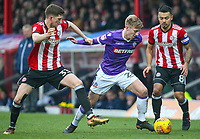 Bolton Wanderers' Harry Charsley holds off the challenge from Brentford's Chris Mepham<br /> <br /> Photographer Alex Dodd/CameraSport<br /> <br /> The EFL Sky Bet Championship - Brentford v Bolton Wanderers - Saturday 13th January 2018 - Griffin Park - Brentford<br /> <br /> World Copyright &copy; 2018 CameraSport. All rights reserved. 43 Linden Ave. Countesthorpe. Leicester. England. LE8 5PG - Tel: +44 (0) 116 277 4147 - admin@camerasport.com - www.camerasport.com