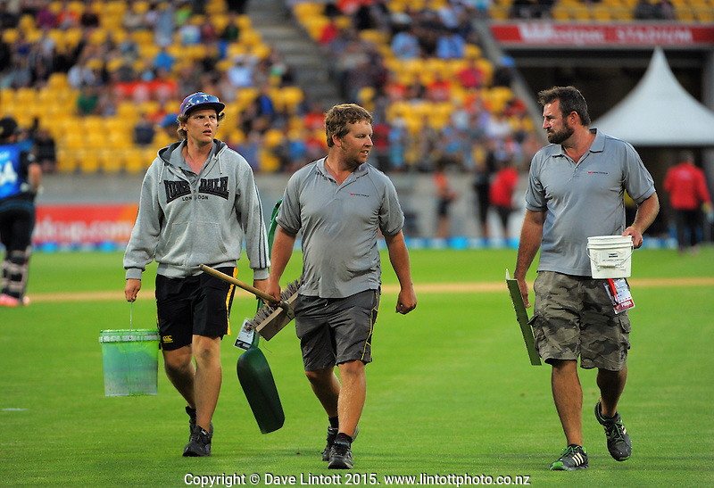 Ground staff walk off the pitch during the one day international cricket match between the New Zealand Black Caps and Sri Lanka at Westpac Stadium, Wellington, New Zealand on Thursday, 29 January 2015. Photo: Dave Lintott / lintottphoto.co.nz