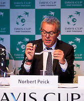 13-09-12, Netherlands, Amsterdam, Tennis, Daviscup Netherlands-Swiss,  Draw, ,Norbert Peick performs the draw.